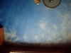 Sky and clouds mural painting on ceiling