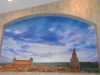 City mural of Spain with clouds and sky